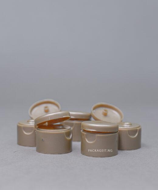 Gold brown flip cap
